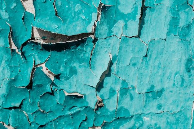 Die textur von abblätternder farbe und rissiger wand