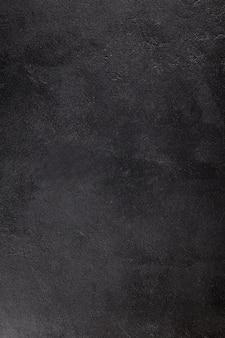 Die textur von beton. fragment aus schwarzem beton. ansicht von oben. gemalte textur. konkreter hintergrund.