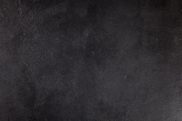 Die textur von beton. fragment aus schwarzem beton. draufsicht gemalte textur