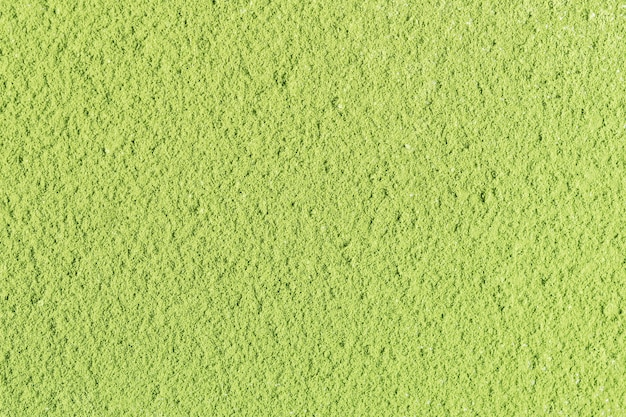 Die textur von grünem matcha-teepulver. draufsicht.