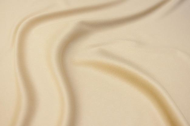 Die textur von kaschmir- oder wollstoff beige oder elfenbein. hintergrundmuster.