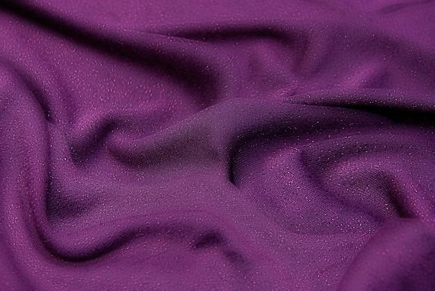 Die textur von seidenstoff in fuchsia. hintergrundmuster.