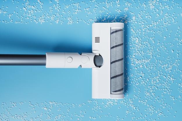Die turbobürste des staubsaugers reinigt weiße kugeln, draufsicht auf blauem hintergrund. das konzept der sauberkeit und reinigung.