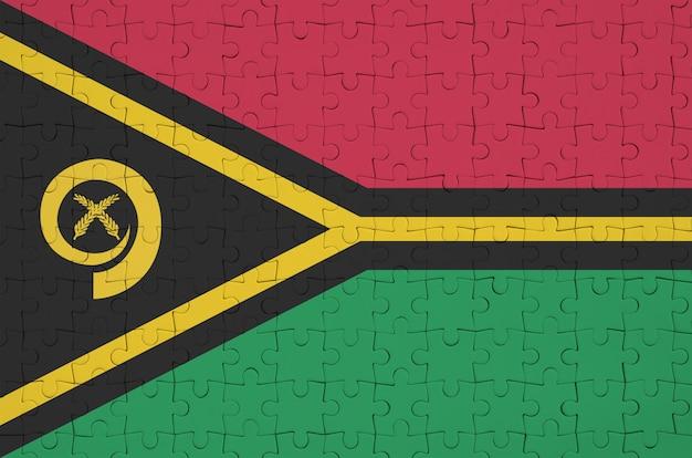 Die vanuatu-flagge ist auf einem gefalteten puzzle abgebildet