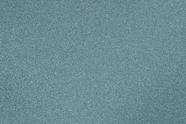 Die verwendung von hellblauer polierter granitbeschaffenheit für den hintergrund.