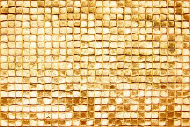 Die wände sind mit goldfliesen verziert, texturhintergrund