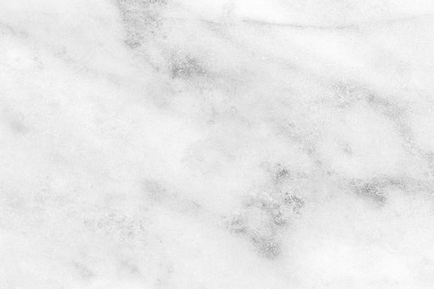 Die weiße schmutzige marmorbeschaffenheit haben staub von und steinmuster.