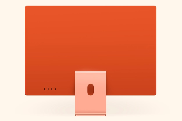 Digitales gerät mit orangefarbenem pastell-computer-desktop-bildschirm mit designbereich