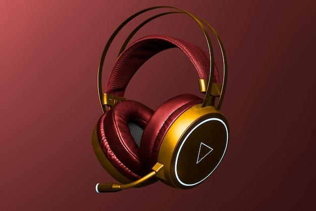 Digitales gerät mit roten und goldenen kopfhörern