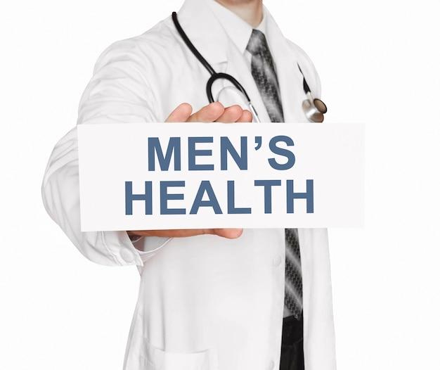Doktor, der eine karte mit dem gesundheitskonzept der männergesundheit hält