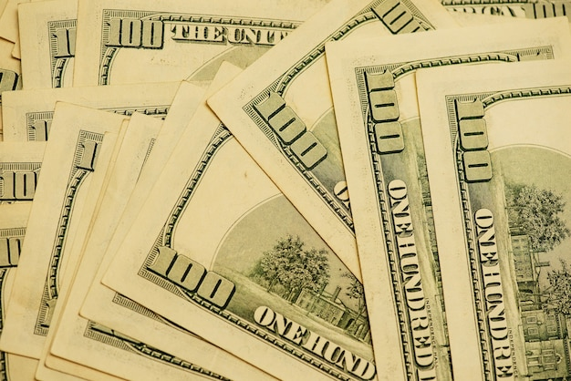 Dollar verschiedene rechnungen. dollar hintergrund. hintergrund verschiedener us-dollar-banknoten. finanzkonzept.