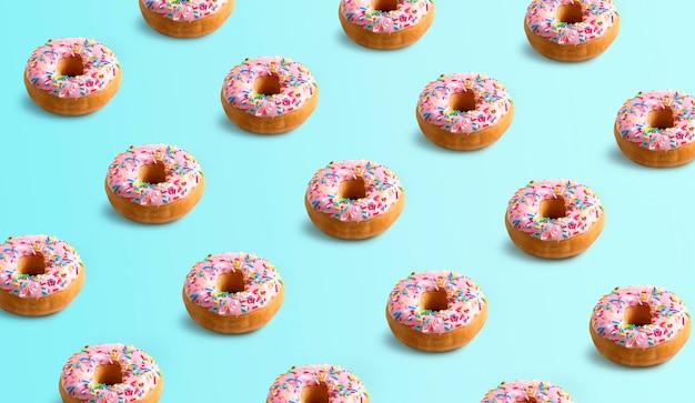 Donuts mit farbigen funken verziert. muster auf blauem hintergrund