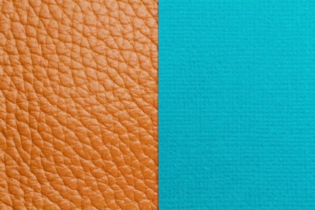 Doppelter hintergrund mit farbigem papier und strukturiertem leder