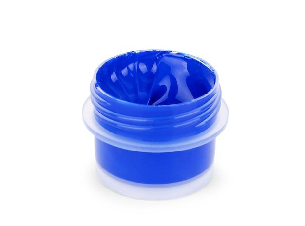 Dosendeckel mit blauer farbe auf weißem hintergrund