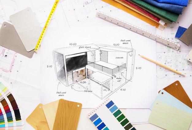 Draufsicht auf ein architektonisches arbeitsbereichsprojekt, umgeben von werkzeugen und materialien