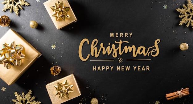 Draufsicht auf weihnachtsgeschenkbox, tannenzapfen, weihnachtsball und schneeflocke.