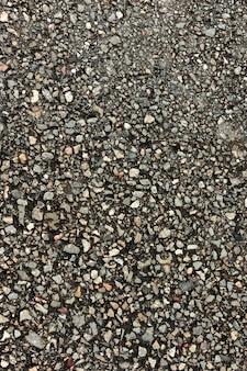 Draufsicht auf zement mit steinen