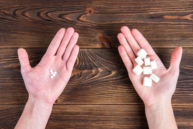 Draufsicht auf zucker und süßstoff