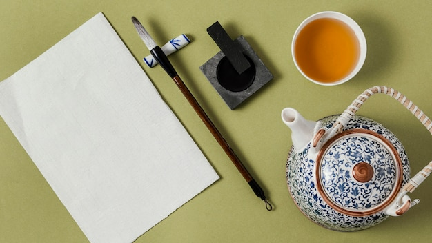 Draufsicht chinesische tinte mit leerer papieranordnung