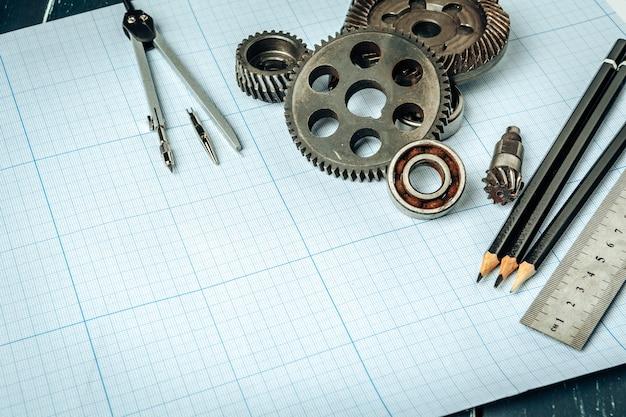 Draufsicht der autotechnikwerkzeuge über millimeterpapier