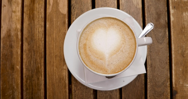 Draufsicht der cappuccinoschale mit lattekunst