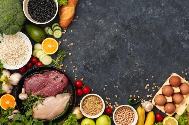 Draufsicht der gesunden nahrungsbestandteile unterschiedlich ein diätlebensmittel-hintergrund copyspace