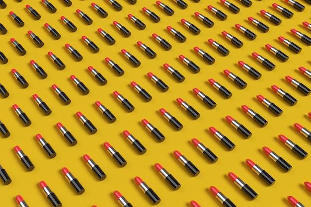 Draufsicht der roten lippenstifte auf gelbem hintergrund.