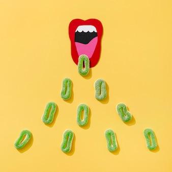 Draufsicht der süßigkeit mit papiermund