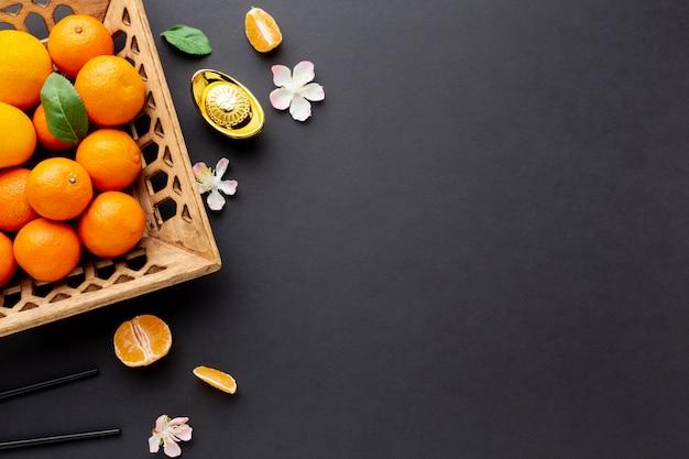 Draufsicht des chinesischen neuen jahres des tangerinekorbes