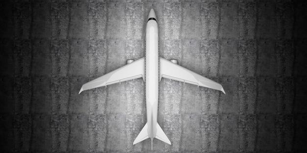Draufsicht des flugzeugs, das auf betonboden am hangar wartet