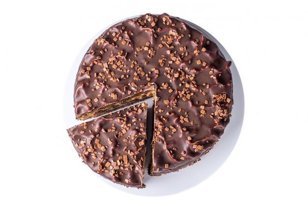 Draufsicht des isolierten schokoladenkuchens auf platte