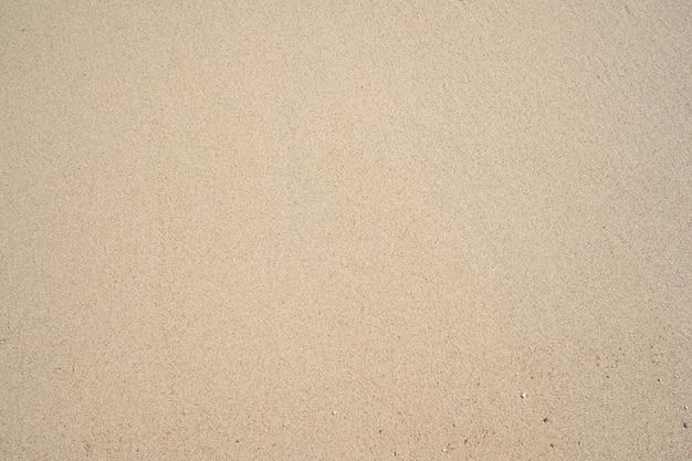 Draufsicht des natürlichen hintergrunds der feinen sandbeschaffenheit sommer- und reisehintergrund.