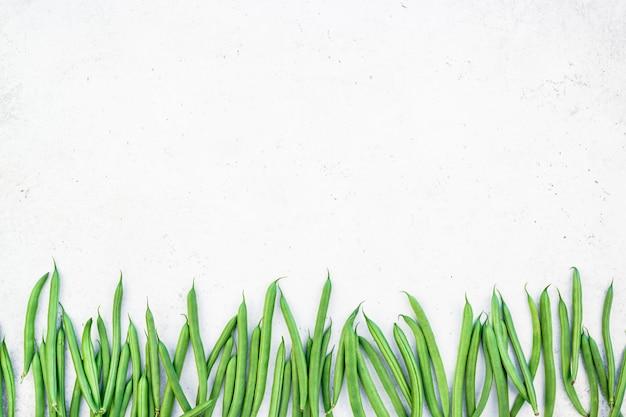 Draufsicht des neuen hintergrundes der grünen bohnen