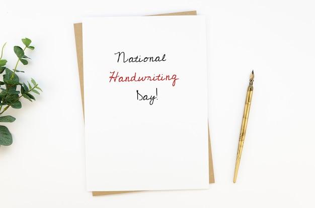 Draufsicht des schriftstellerarbeitsbereichs für nationalen handschrifttag