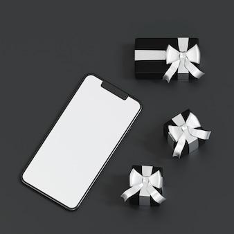 Draufsicht des smartphones mit schwarzer geschenkbox