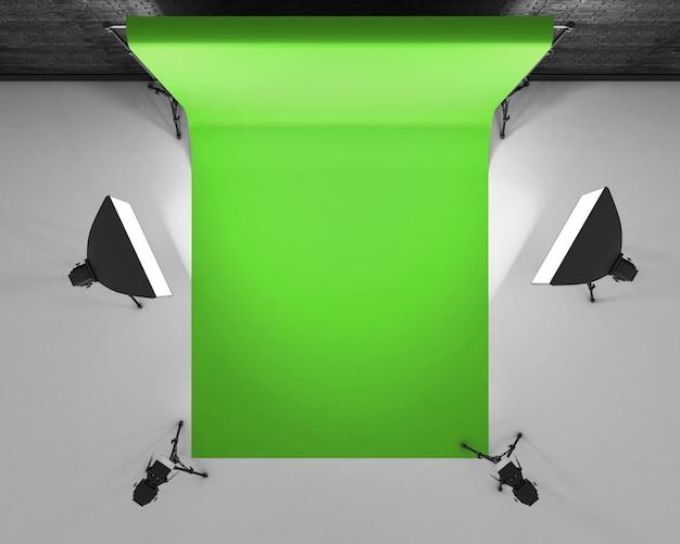 Draufsicht greenscreen studio mit leuchtkasten und softbox. filmstudio mit grünem hintergrund. 3d-rendering.
