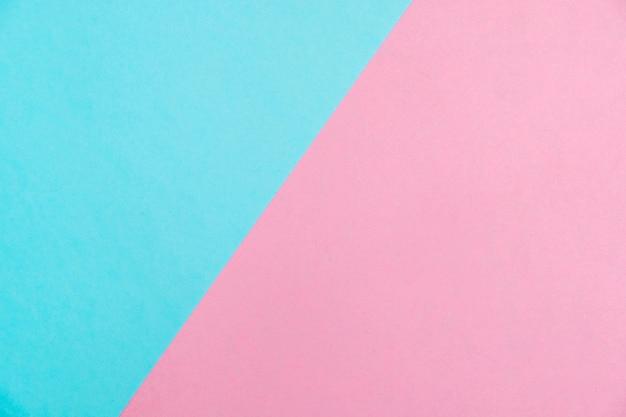 Draufsicht, hintergrundbeschaffenheit, rosa und blau der farbigen papierpastellebene lage.