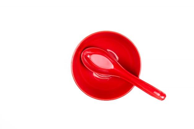 Draufsicht, löffel in einer roten schüssel.