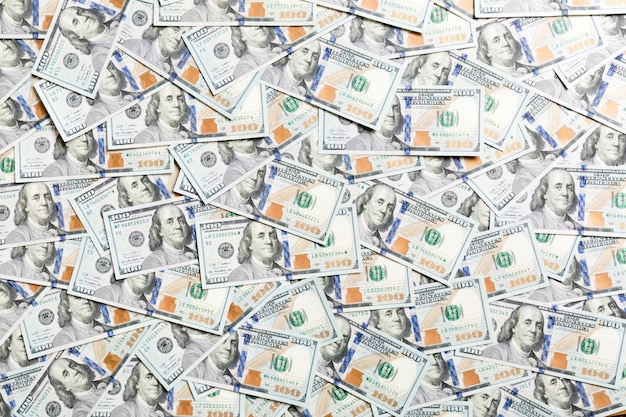 Draufsicht von hundert dollarbanknoten gemacht als hintergrund. usd währung. textur der amerikanischen dollar