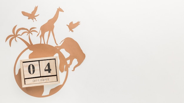 Draufsicht von papiertieren mit globus und kalender für tiertag
