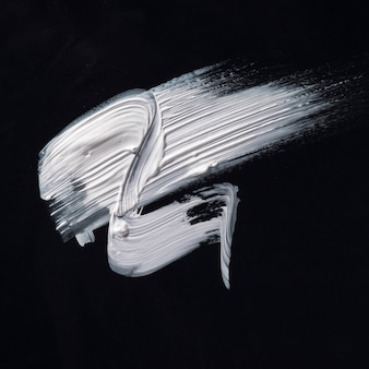Draufsicht weißer cremiger pinselstrich