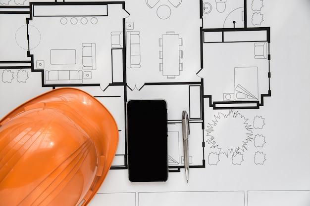 Draufsichtingenieurplan auf hölzernem hintergrund