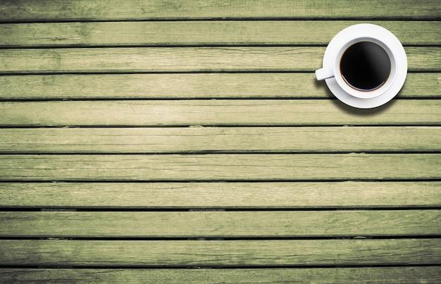 Draufsichtkaffeetasse auf hintergrundholz