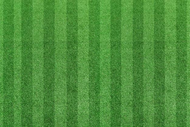 Draufsichtstreifengrasfußballfeld. grüner rasenmusterhintergrund