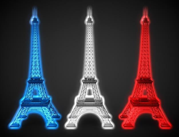 Drei eiffeltürme leuchten in den farben der französischen flagge auf schwarzem hintergrund