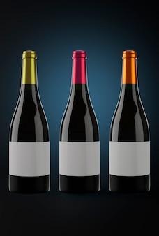 Drei flaschen rotwein in einem dunklen hintergrund