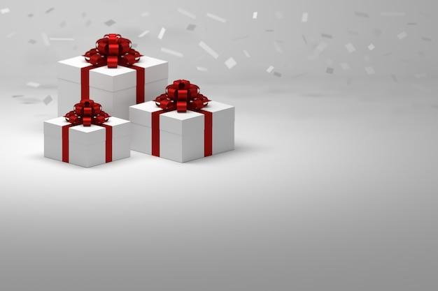 Drei geschenkgeschenke mit rot glänzenden schleifen mit fallendem weißem konfetti auf weißer oberfläche