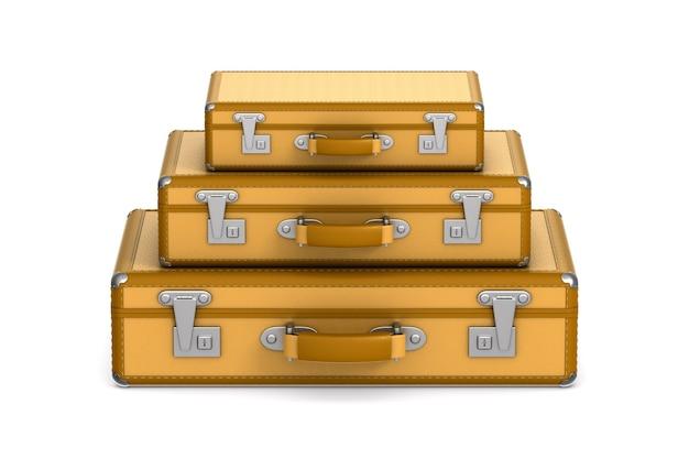 Drei geschlossene reisetaschen auf weiß