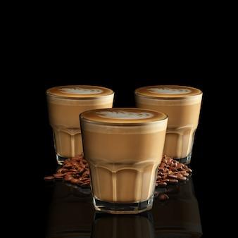 Drei gläser cappuccino getrennt auf schwarzem