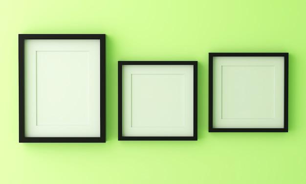Drei leere schwarze bilderrahmen zum einfügen von text oder bild in pastellgrüne farbe.